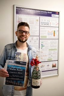 "Towards entry ""Poster award to Christian Heide at the 5th International Symposium on Synthetic Carbon Allotropes"""